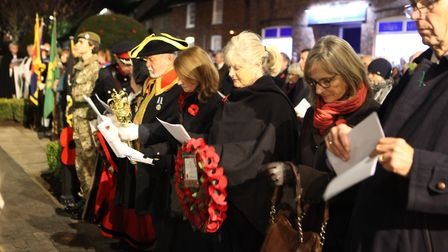 Anne Main MP holds a wreath alongside other local dignitaries at the St Albans Remembrance Day Parad