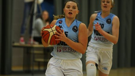 Lauren Milligan (back) says teams in the WBBL should be scared of Oaklands Wolves in their current f