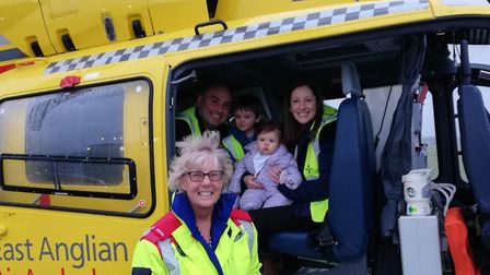 Emma Howard and her fiance Phil with children Dexter and Jessie and Dr Pam Chrispin, who helped save
