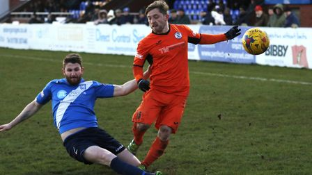 St Ives Town substitute Ben Seymour-Shove is challenged by a Stratford defender. Picture: GEMMA THOM
