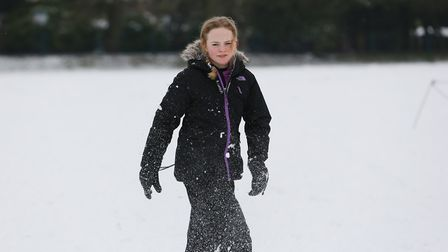 The Savage family play in the snow in Clarence Park, St Albans. Picture: DANNY LOO