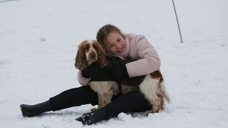 The Savage family with Toffee the dog play in the snow in Clarence Park, St Albans. Picture: DANNY L