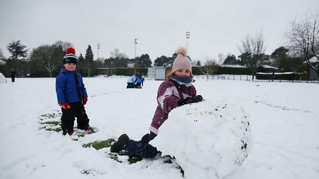 The Betteley family play in the snow in Clarence Park, St Albans. Picture: DANNY LOO