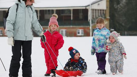 The Dennis family play in the snow in Clarence Park, St Albans. Picture: DANNY LOO