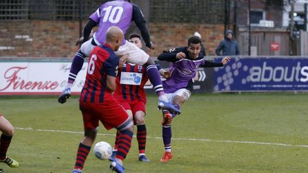 Zane Banton guides the ball in tot he back of the net to secure all three points for the Saints. Pic