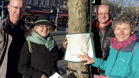 Cllr Simon Grover, Jill Mills, James Lomas and Kate Bretherton attaching a price tag to a tree in St