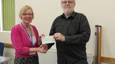 Pat Morritt, presented a cheque to David Wherrell of Royston and District Community Transport. Pictu