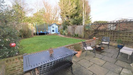 The rear garden has patio and lawn areas. Picture: Aitchisons
