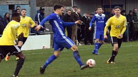 The ineligible Chris Hyem on the ball during Godmanchester Rovers' FA Vase clash with Sporting Khals