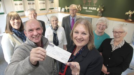Linda Clare, sales development manager at The Park presenting cheques worth £500 each to Ian Huckles