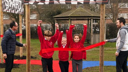 Pupils Harry, Chloe, and Lily at Priory Junior School on their daily mile track. Picture: ARCHANT
