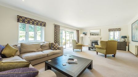 Sliding doors lead from the sitting room to the rear patio. Picture: John Curtis