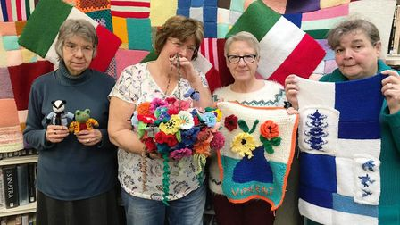 Knitting volunteers with some of the items created for the Bridge Arts Festival. Picture: ARCHANT
