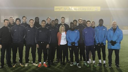 Stacey Turner with St Albans City FC players at Clarence Park.