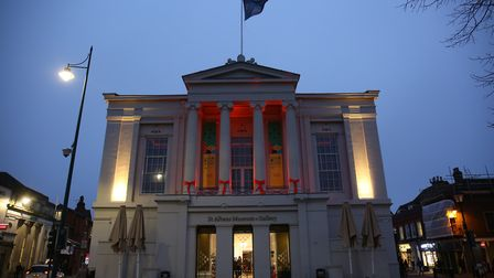 The outside of St Albans Museum + Gallery is lit up in orange to celebrate the launch of Children's