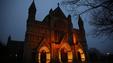 The outside of St Albans Abbey is lit up in orange to celebrate the launch of Children's Mental Heal