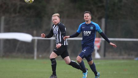 Colney Heath V Arlesey Town - Frank Jowle for Colney Heath battles with Jason Darvell for Arlesey To
