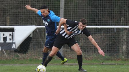 Colney Heath V Arlesey Town - Lorrell Smith for Arlesey Town battles with Greg Shaw for Colney Heath