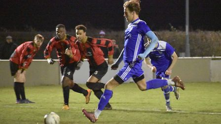 Jack Chandler fires Godmanchester Rovers ahead from the penalty spot at Huntingdon. Picture: JAMES R