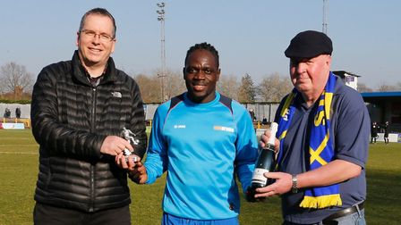 St Albans City's Solomon Sambou receives his player of the month award for January 2019 from Tim Pet