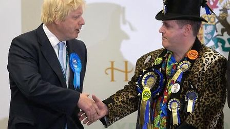 Lord Toby Jug wearing the famous coat with Boris Johnson. Picture: CONTRIBUTED