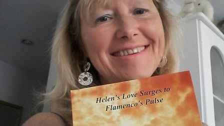Julie with her book, Helen's Love Surges to Flamenco's Pulse. Picture: Julie Silverton