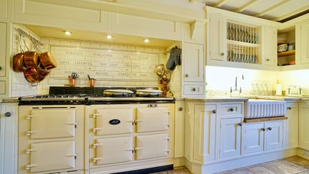 The property benefits from tastefully fitted kitchen with Aga multi-fuel stove. Picture. Giggs & Bel