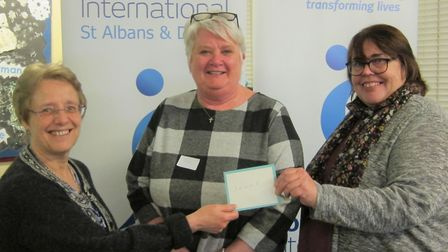 Soroptimists club president Linda handing the cheque to St Albans and Hertsmere Women's Refuge. Pict