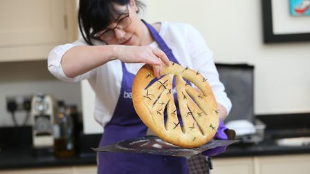 The Royston Crow chief reporter Bianca Wild is shown the basics of bread making by The Bakery at Num