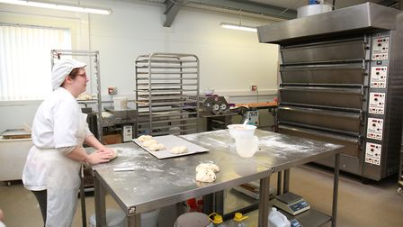 China Simpson at work at Bury Lane Bakery. Picture: DANNY LOO