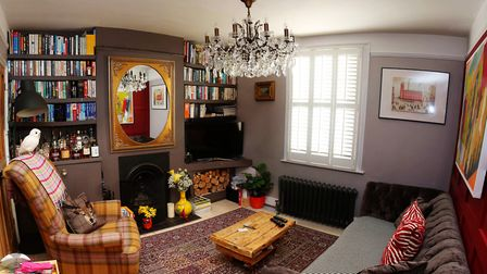 The cosy sitting room was designed with adults in mind, but Stuart admits that daughter Peggy's toys