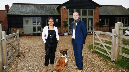 Indira Chima, her husband John Coyle and their dog Juno outside their Markyate home, which featured