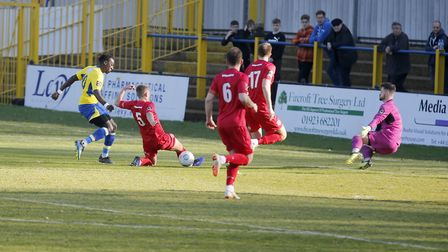 David Moyo is denied by the outstretched Truro keeper Harvey Rivers. Picture: LEIGH PAGE