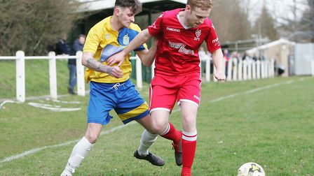 Harpenden Town V Baldock Town - Archie McCelland for Harpenden Town battles with Joshua Furness for