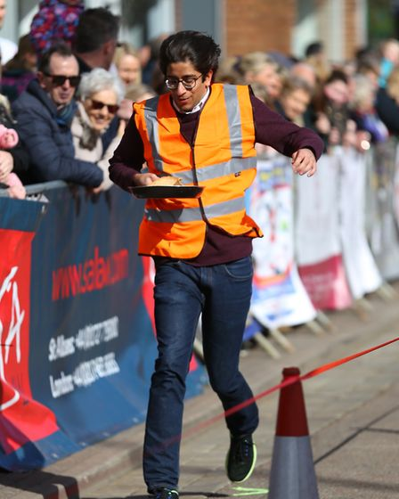 Competitors in the St Albans pancake race 2019. Picture: DANNY LOO