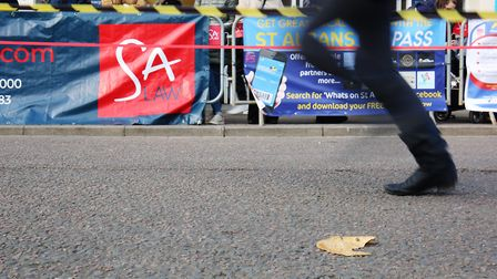 A broken pancake lies on the floor as competitors race past in the St Albans pancake race 2019. Pict