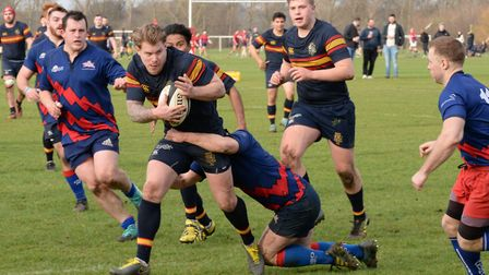 Tabard's Jack Reilly looks to evade the Old Streetonians' defence.