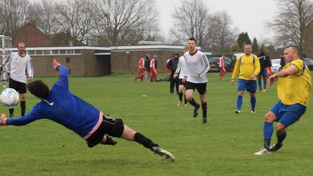 Mark Burgess of Tansley scores one of his two goals against Snug Bar. Picture: BRIAN HUBBALL