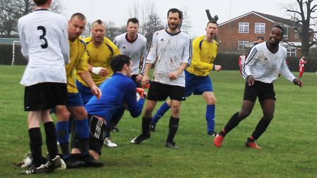 Tom Clayton of Snug Bar makes a save in a crowded goalmouth. Picture: BRIAN HUBBALL