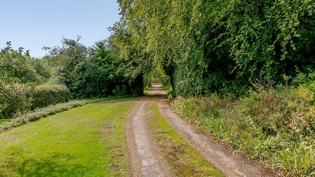 It is situated down a long drive on the edge of the village. Picture: Carter Jonas
