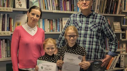 Mum Siande, Daisy, aged 8, her sister Lily, aged 11 and Oxfam manager Geoffrey Stalker.