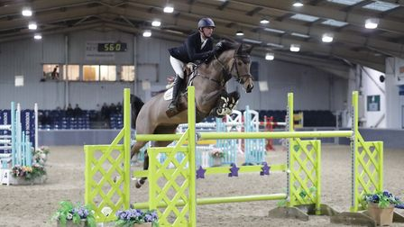 Phillip Miller & Sussex Caretino in action in the Winter Grand Prix at The College Equestrian Centre
