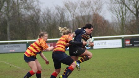 Mica Gooding battles to escape the attention of the Medway defenders. Picture: EMMA COOKE