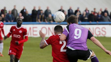 Sam Merson heads the ball across the box for Zane Baton to open the scoring. Picture: LEIGH PAGE