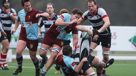 Harpenden V Chiswick -Harpenden's Michael Goode is hauled down to earth against Chiswick.Picture