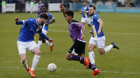 Zane Banton of St Albans City gets between two Wealdstone defenders. Picture: LEIGH PAGE