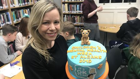 Stacey Turner with the cake made by Lucy Clark of Heaven is a Cupcake.