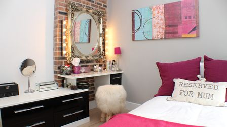 The second double bedroom has an exposed brick dressing area with fitted drawers. Picture: Bradford