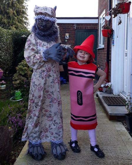 Marley, nine, as Grandma Wolf and Hadley, four, as The Day the Crayons Quit for World Book Day. Pict