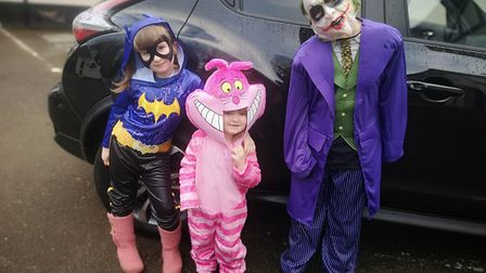 McKenzie, seven, as BatGirl, Freya, three, as the Cheshire Cat and Riley, nine, as the Joker for Wor